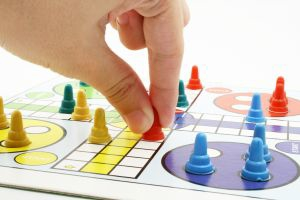 detailed image of a person playing a board game